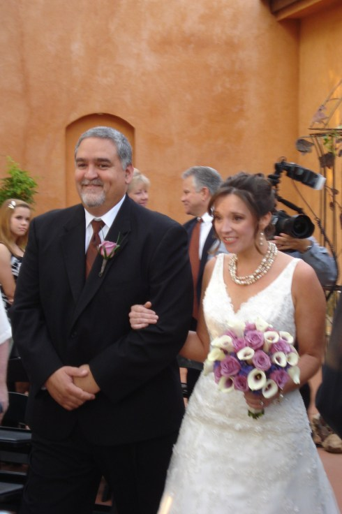 My dad walked Tracy down the aisle.  She was gorgeous.